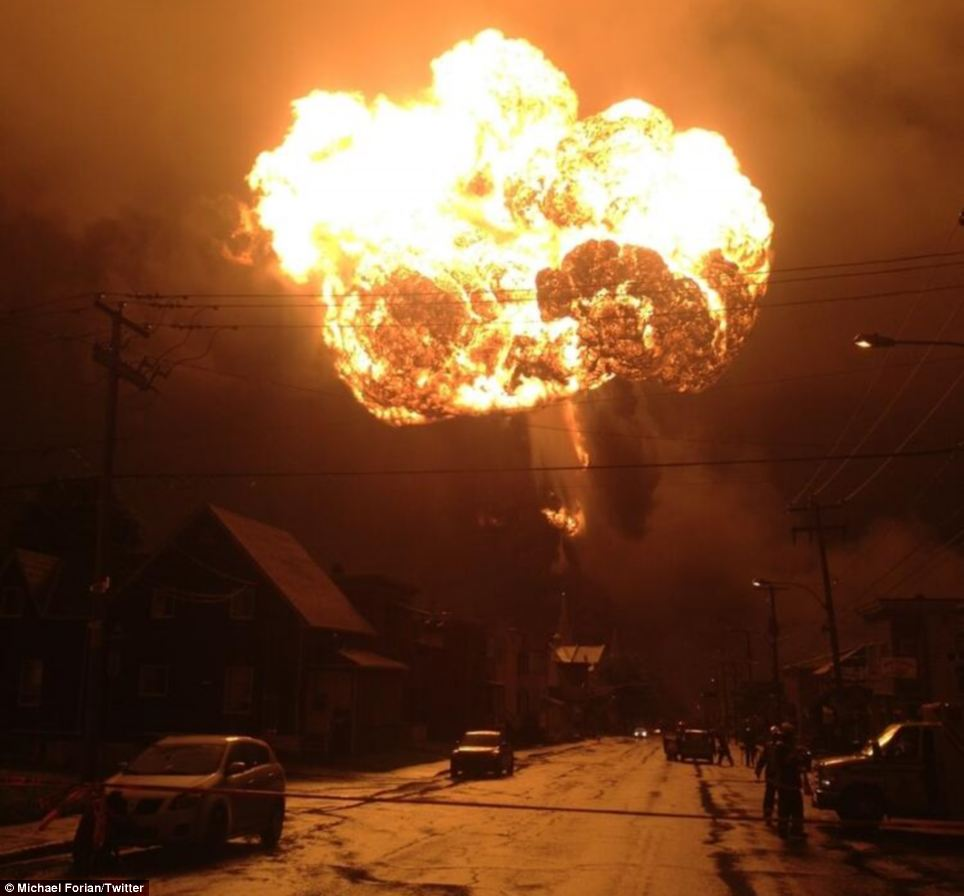 A fireball bursts from the wreckage of a train carrying Bakken Shale crude in July 2013 in Lac-Mégantic, Quebec, Canada